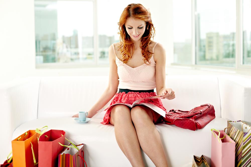 Redheaded Woman Reading A Magazine