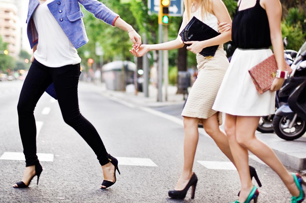 Group Of Women Crossing The Street In Heels