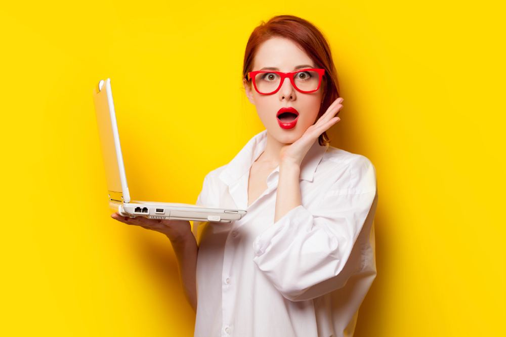 Woman Wearing Glasses Surprised By Something On Her Computer